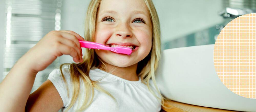 kid brushing teeth in bathroom