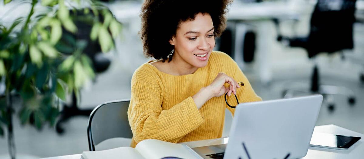 woman enrolling in dental insurance on laptop
