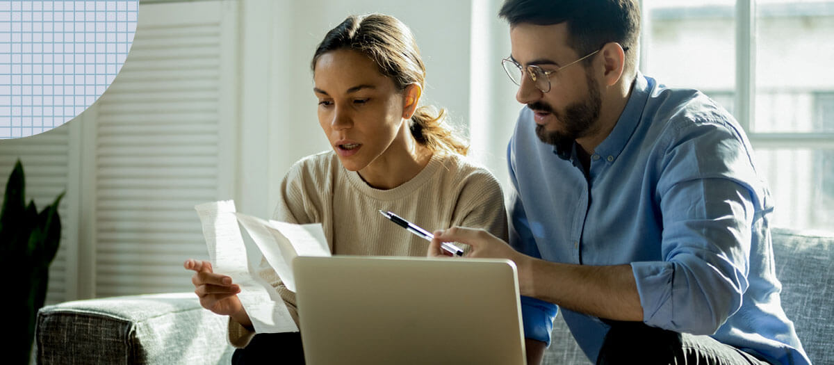 Man and woman looking at open enrollment documents