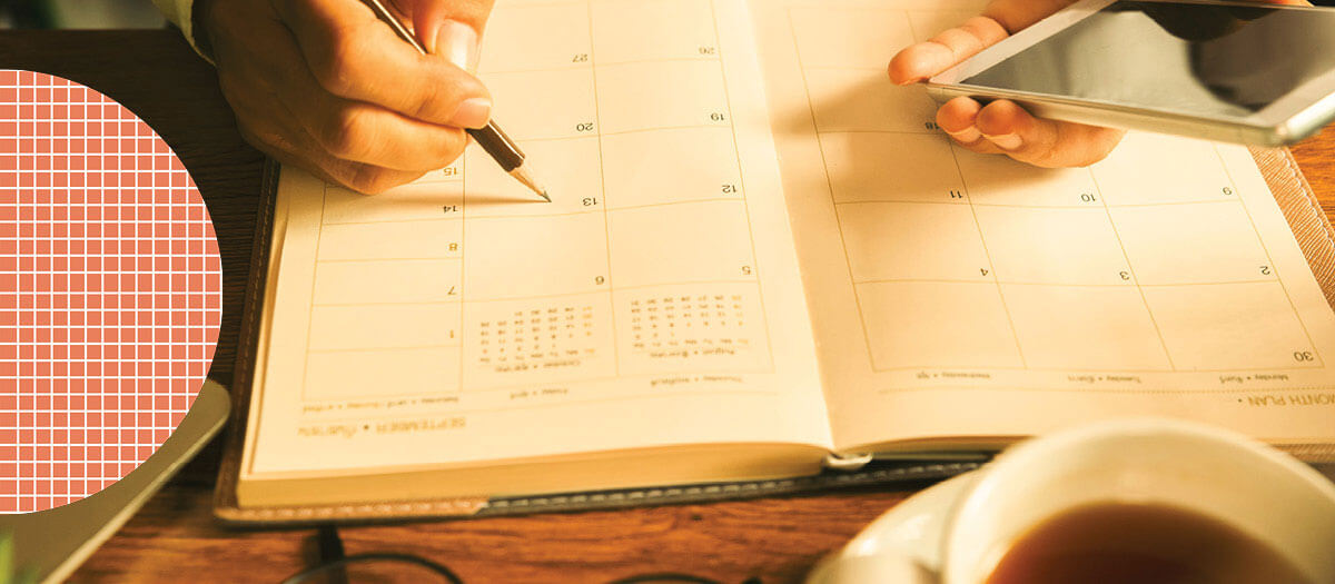 Person filling out calendar