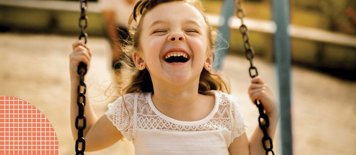 Girl smiling on swings
