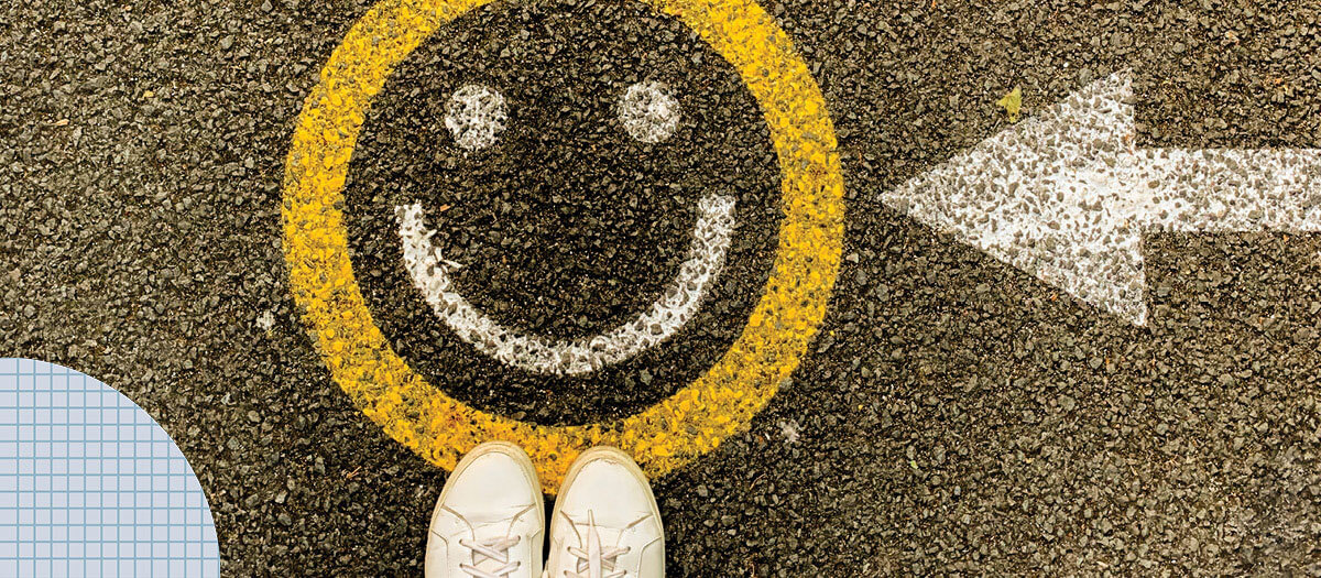 Smiley face painted on pavement