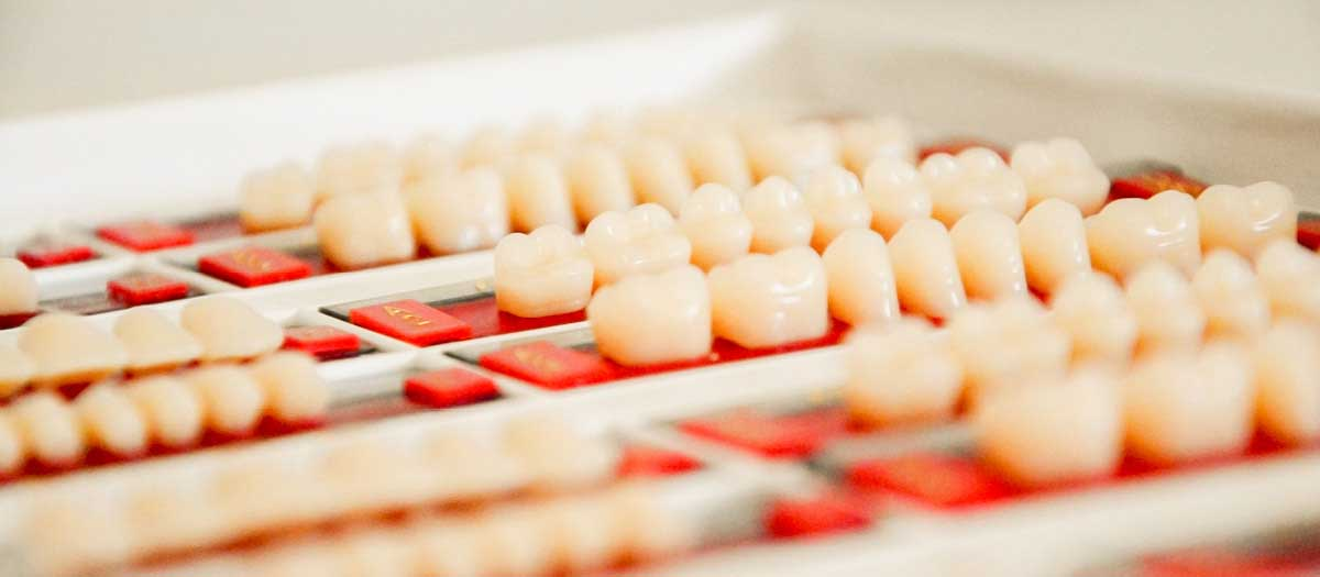 Line of dental implants on table