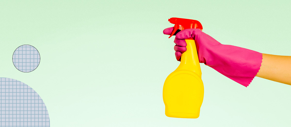 Gloved hand with cleaning spray