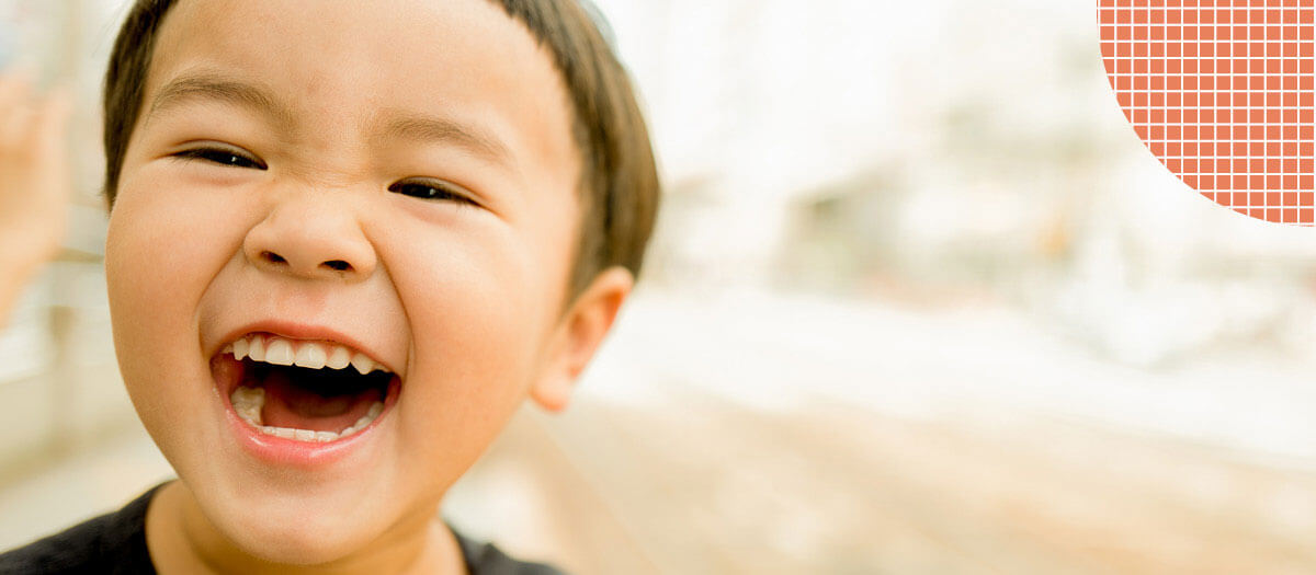 Kid smiling and laughing
