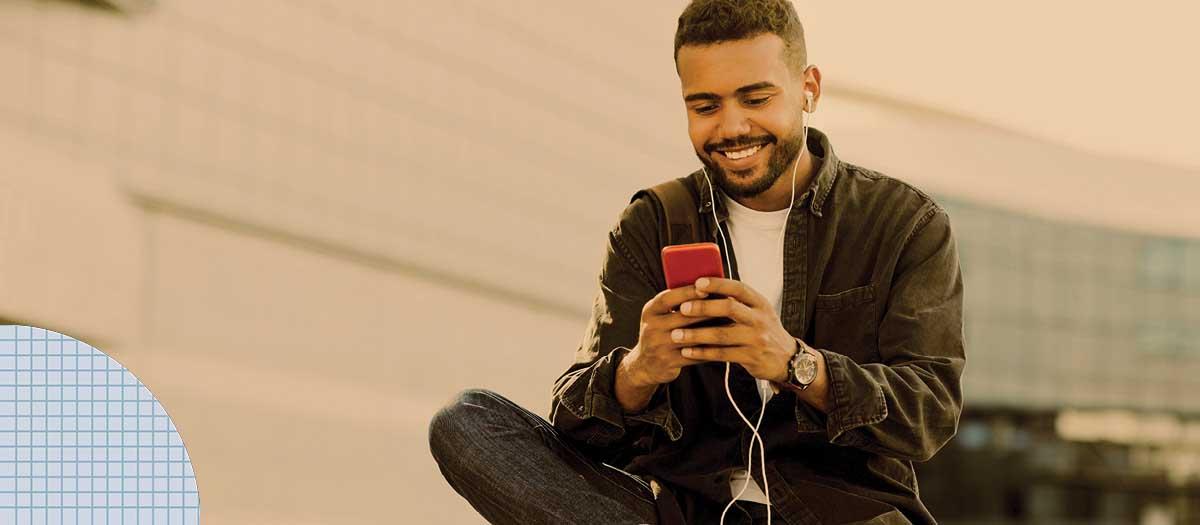 Millennial man texting on cellphone