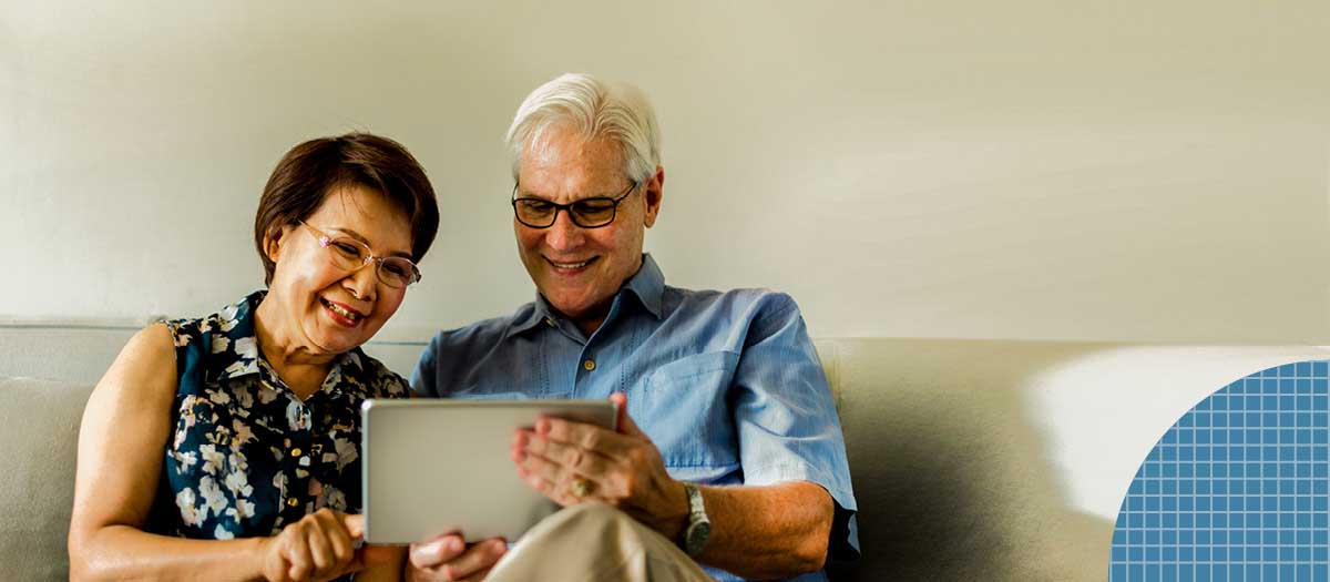 Two people with dentures using tablet