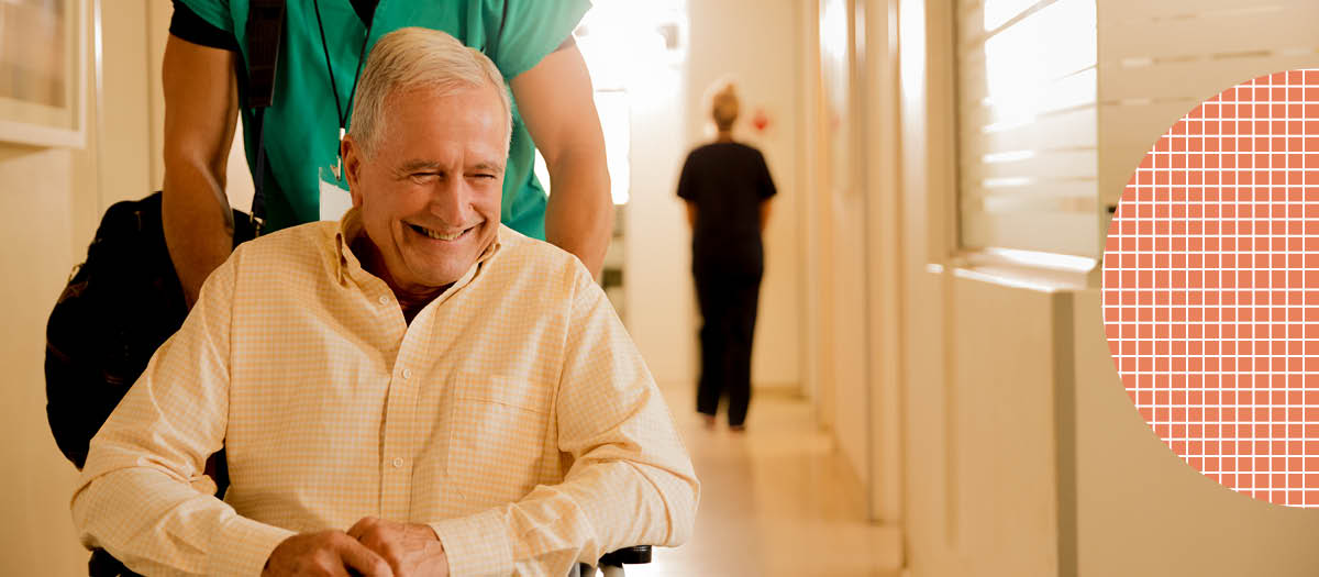 Pushing a senior man in wheelchair
