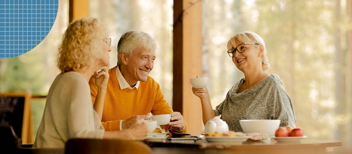 Three retired people having coffee and morning snacks