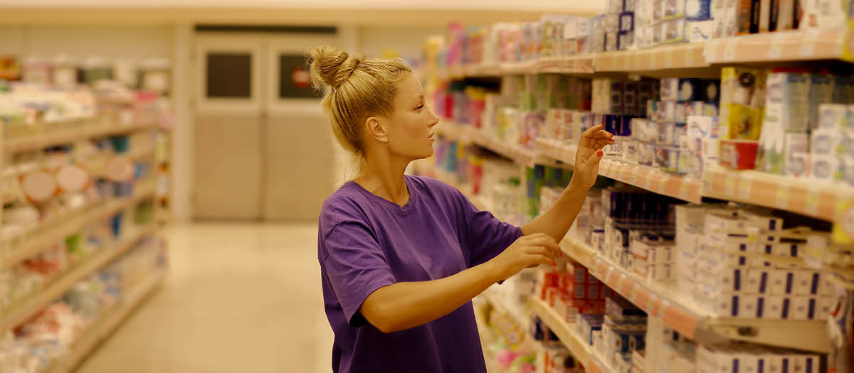 Woman shopping for dental health supplies in store