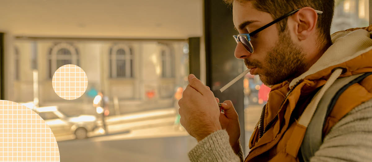 Man lighting up a cigarette outside