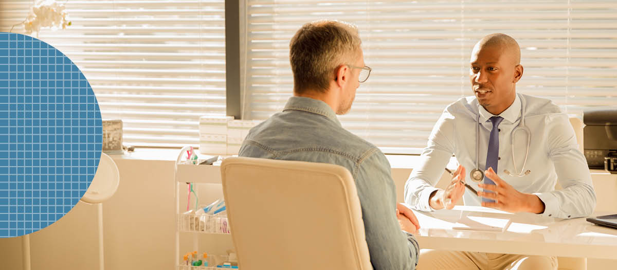 Doctor talking to male patient at a table