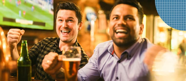 Two men at a sports bar drinking beer
