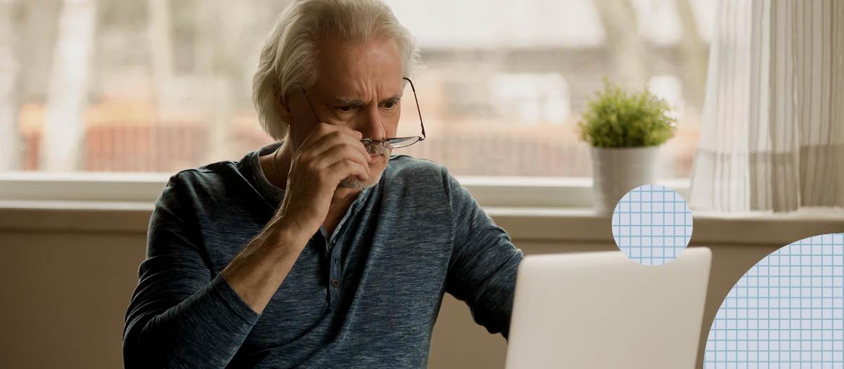 Senior man looking at computer