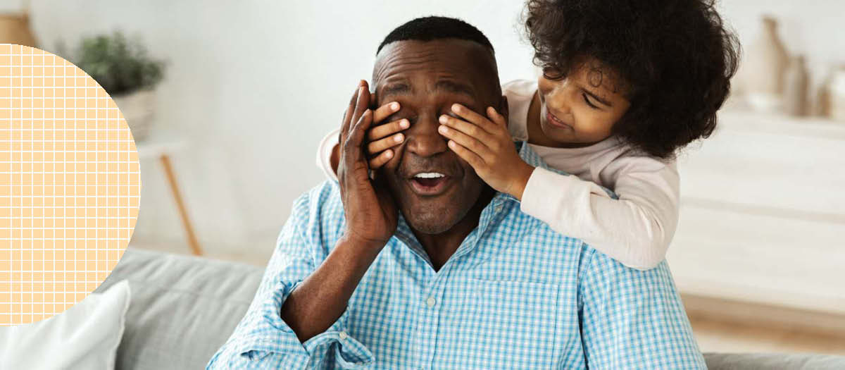 Daughter covering her dad's eyes with hands
