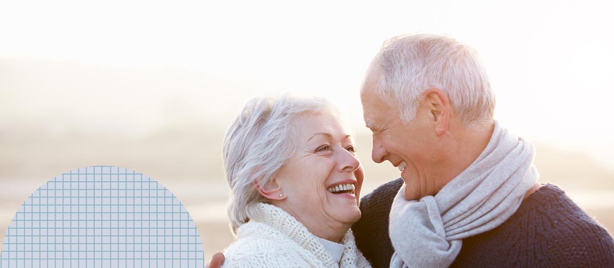 senior couple looking smiling affectionately
